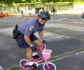 Policeman On The Pink Bike